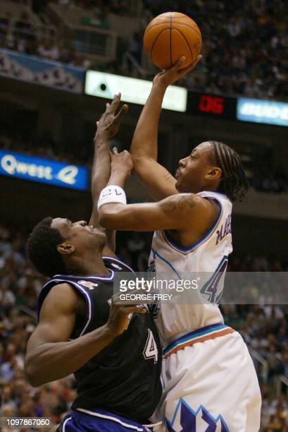 Donyell Marshall of the Utah Jazz puts a shot over Chris Webber of the Sacramento Kings during the first quarter of game 3 first round of the Western...