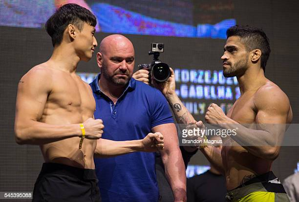 Doo Ho Choi and Thiago Tavares face off during The Ultimate Fighter Finale Weighin at TMobile Arena on July 7 2016 in Las Vegas Nevada