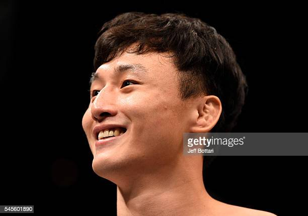 Doo Ho Choi of South Korea celebrates after his knockout victory over Thiago Tavares of Brazil in their featherweight bout during The Ultimate...