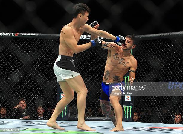 Doo Ho Choi of South Korea fights Cub Swanson of the United States in their Featherweight bout during the UFC 206 event at Air Canada Centre on...