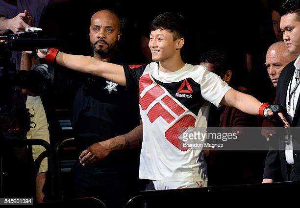 Doo Ho Choi of South Korea prepares to enter the Octagon before his featherweight bout against Thiago Tavares of Brazil during The Ultimate Fighter...