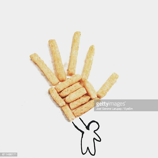 Doodle With Hand Made Of French Fries On White Paper