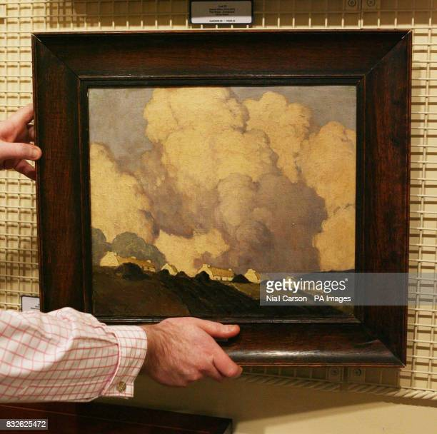 'Dooega Achill Island Co Mayo' by Ulster artist Paul Henry which was uncovered in an episode of the BBC's Antiques Roadshow is held at a preview of...
