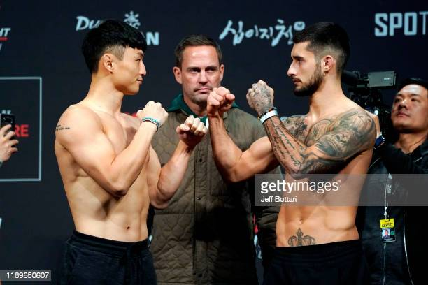 Dooho Choi of South Korea and Charles Jourdain of Canada face off during the UFC fight night weighin at Sajik Arena on December 20 2019 in Busan...