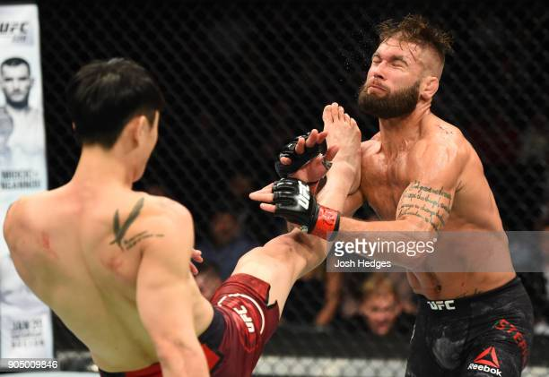 Dooho Choi of South Korea kicks Jeremy Stephens in their featherweight bout during the UFC Fight Night event inside the Scottrade Center on January...