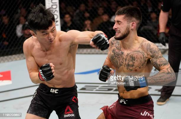 Dooho Choi of South Korea punches Charles Jourdain of Canada in their featherweight fight during the UFC Fight Night event at Sajik Arena 3 on...