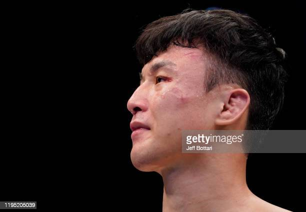 Dooho Choi of South Korea reacts after his knockout loss to Charles Jourdain of Canada in their featherweight fight during the UFC Fight Night event...