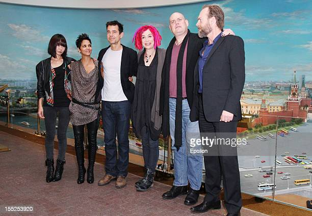 Doona Bae Halle Berry Tom Tykwer Lana Wachowski Andy Wachowski and Hugo Weaving pose for photographers during the 'Cloud Atlas' film photocall at the...