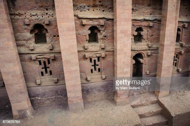 door and columns of bet medhane alem, lalibela, ethiopia - lalibela stock photos and pictures