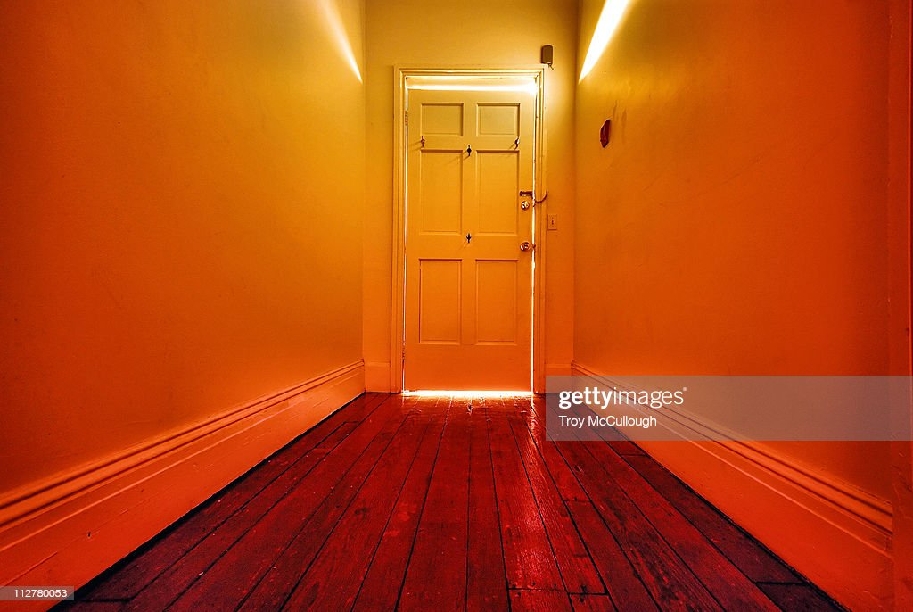 Door at end of hall : Stock Photo