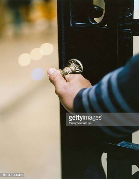 door attendant holds handle - doorman stock photos and pictures