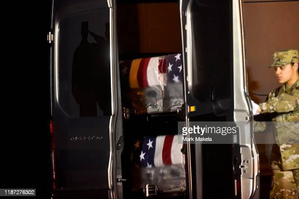 Door attendant Staff Sgt Siannie L Concepcion closes the van door transporting three transfer cases for fallen US Navy service members Airman...