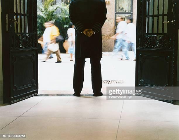 Door Attendant Stands by Doors