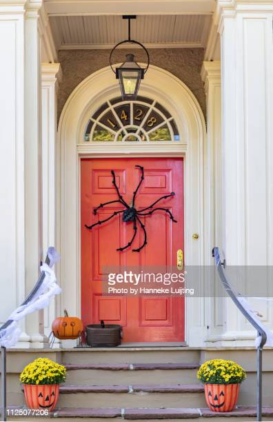 door decorated for halloween in the garden district of new orleans - halloween decoration stock pictures, royalty-free photos & images
