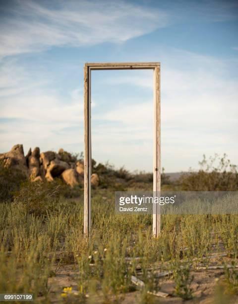 A door frame stands in a field near Palmdale, California.