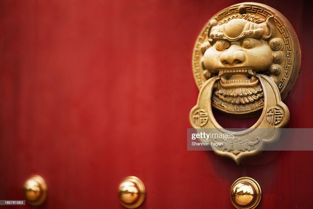 Door handle on Red Temple Door : ストックフォト