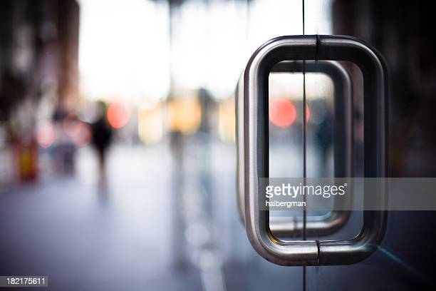 door handles on a glass office building - handle stock pictures, royalty-free photos & images
