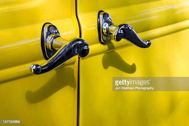 door handles on an antique yellow car - handle stock pictures, royalty-free photos & images