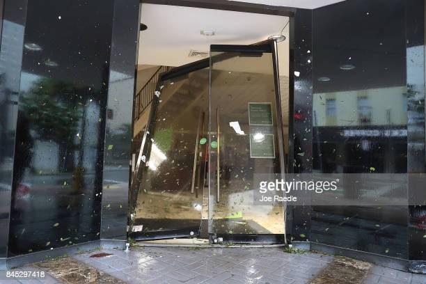 A door is seen blown in at a Regions Bank as Hurricane Irma passes through on September 10 2017 in Miami Florida Hurricane Irma made landfall in the...