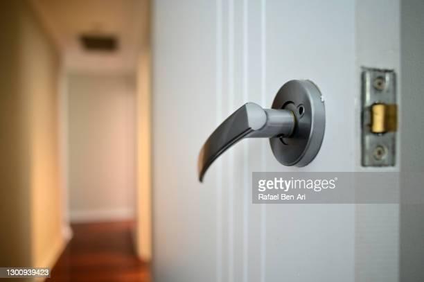 door knob and empty corridor - rafael ben ari fotografías e imágenes de stock