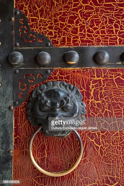 Door knocker detail on old hutong door, Beijing