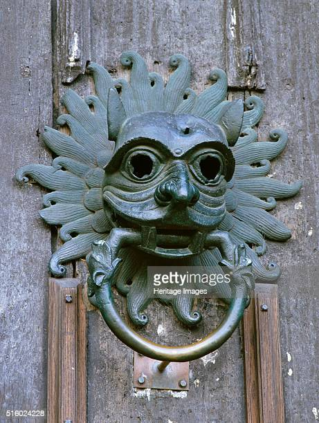 Door knocker in the shape of a mask sanctuary of Durham Cathedral County Durham c2000s Artist Unknown