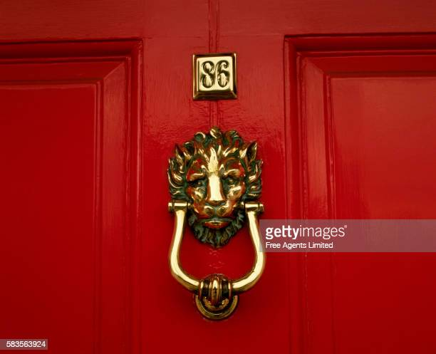 Door Knocker on Red Door