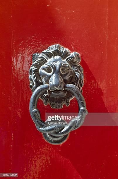 door knocker with a lion's head - door knocker stock photos and pictures