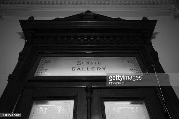 Image has been shot in black and white. Color version not available.) A door leading to the Senate Chamber is seen at the Texas State Capitol in...