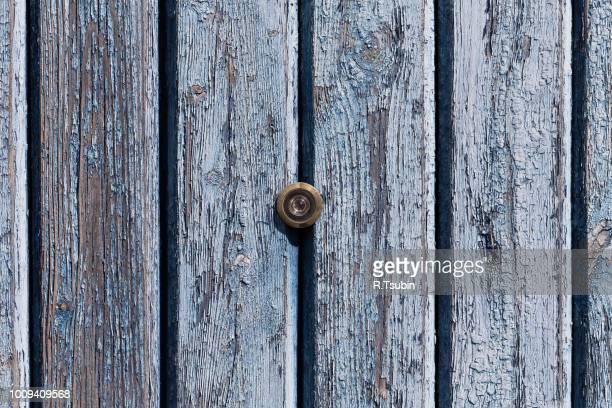 door lens peephole on old wooden texture