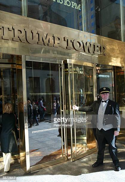 A door man holds the door at Trump Towers April 15 2004 in New York City