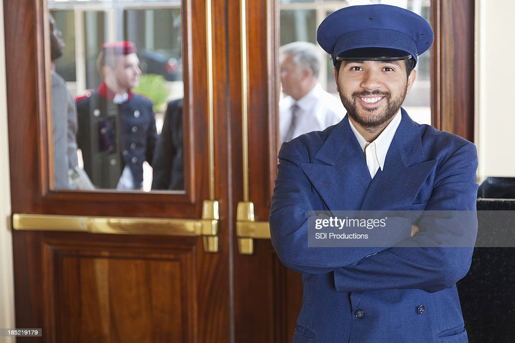 Door man portrait at a 5-Star hotel entrance : Stock Photo