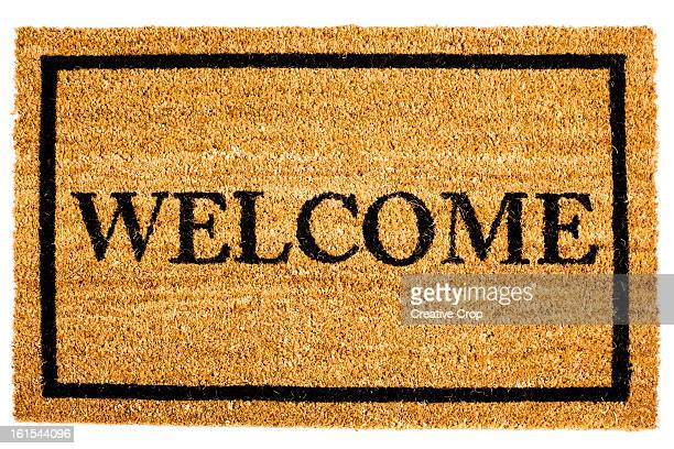 Door mat with 'welcome' sign