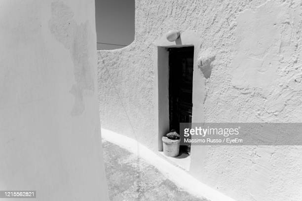 door of building with white walls in a small town of greece. - whitewashed stock pictures, royalty-free photos & images