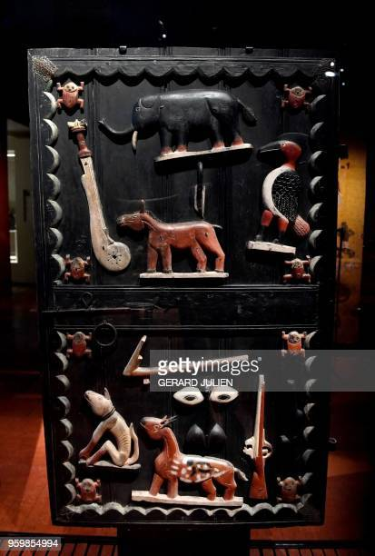 Door of the palace of King Glegle of the Kingdom of Dahomey dating back to 18801889 is pictured on May 18 2018 at the Quai Branly MuseumJacques...