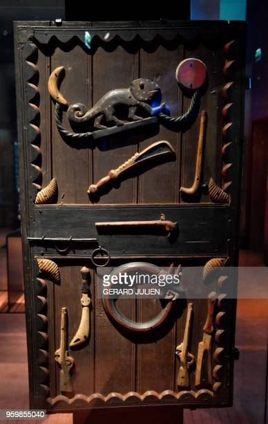 Door of the palace of King Glegle of the Kingdom of Dahomey dating back to 18801889 is pictured on June 18 2018 at the Quai Branly MuseumJacques...