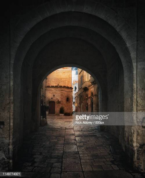 door of time - polignano a mare stock photos and pictures