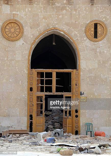 A door of Umayyad Mosque destroyed after clashes between Asad regime forces and Syrian opponents is seen in Aleppo Syria on September 27 2014