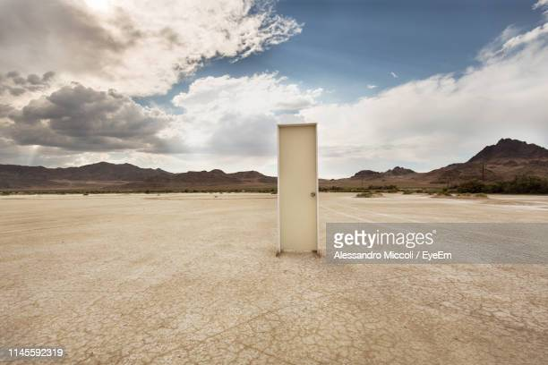 door on barren landscape - alessandro miccoli stockfoto's en -beelden