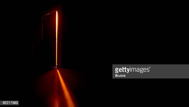 door opening in the dark - mystery stock pictures, royalty-free photos & images