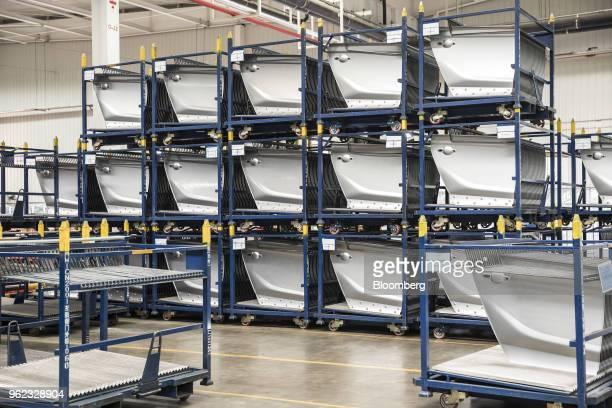 Door panels sit on racks in the press shop at the SAICGMWuling Automobile Co Baojun Base plant a joint venture between SAIC Motor Corp General Motors...