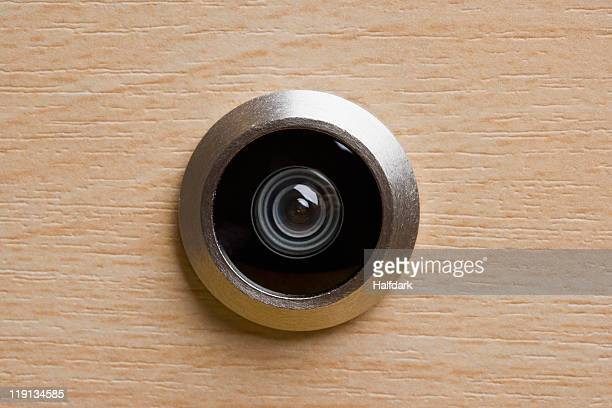 Door peephole, extreme close-up