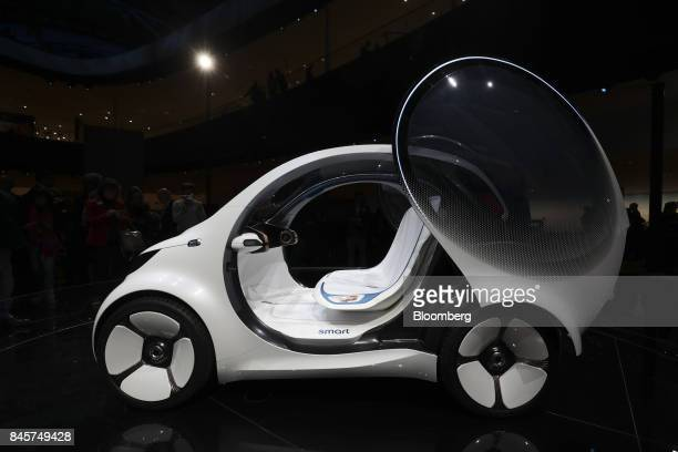 A door sits open on a Daimler Smart Vision EQ fortwo electric autonomous selfdriving concept automobile during the Daimler media night ahead of the...