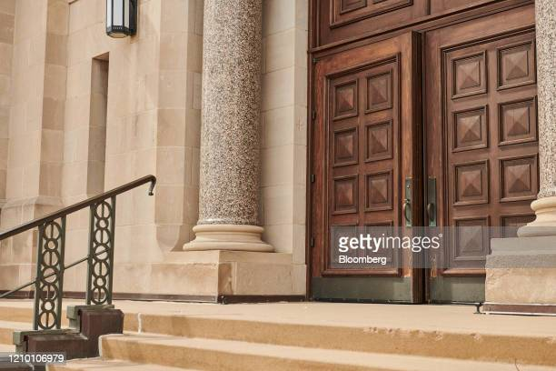 A door stands slightly open at the Cathedral of Saint Joseph in Sioux Falls South Dakota US on Wednesday April 15 2020 South Dakota Governor Kristi...