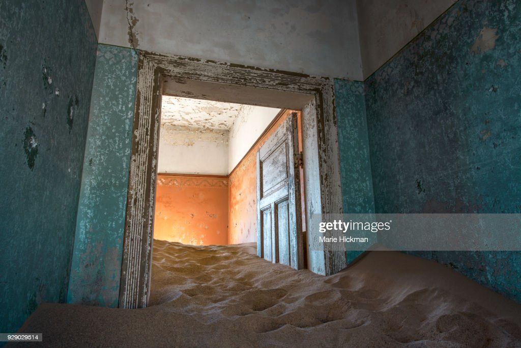 Door stuck in the sand inside a home in Kolmanskop an abandoned Diamond Mining Town a Tourist Destination in Namibia Africa. & Door Stuck In The Sand Inside A Home In Kolmanskop An Abandoned ...