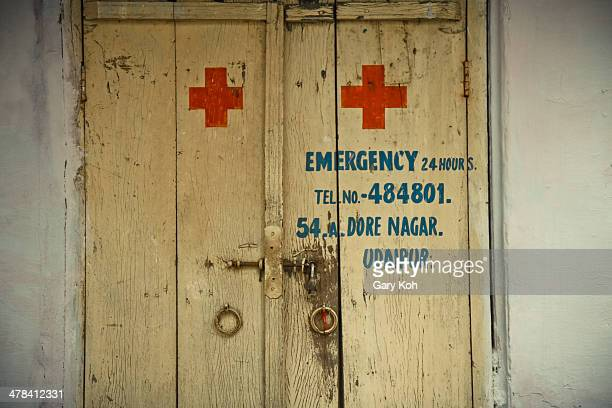 Door to a medical clinic spotted around Udaipur, India. It bears the internationally-recognized Red Cross symbol. Udaipur, Rajasthan, India