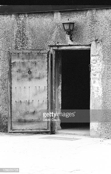 door to gas chamber, birkenau concentration camp, auschwitz, poland - birkenau stock pictures, royalty-free photos & images