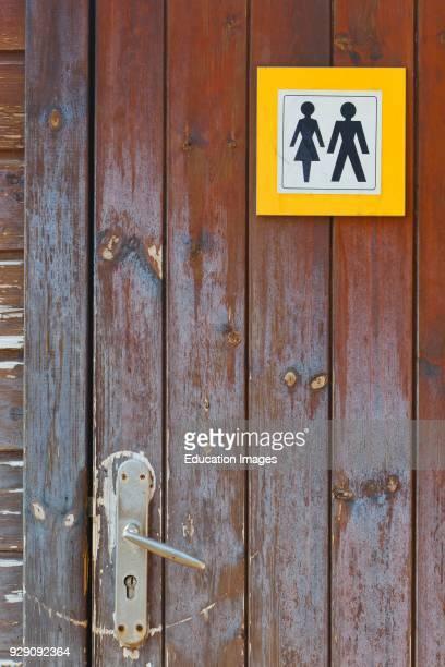 Door to toilet for men and women on Burriana beach Nerja Malaga Province Costa del Sol Spain