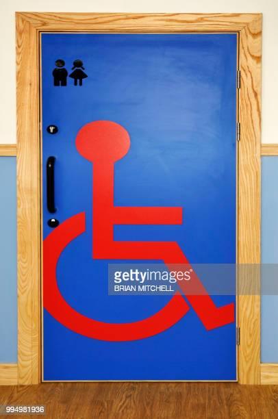 Door with easy read handicapped symbol