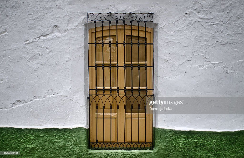 Door with iron grill : Stock Photo